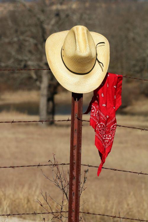 Cowboy Hat And Bandana On Fence