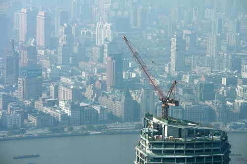 crane,skyscraper,outlook,skyscrapers,city construction site,construction work,crane boom,shanghai