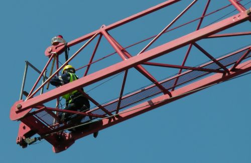 Crane Operator Checking Cables