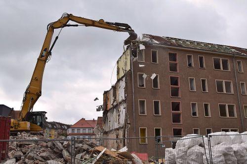 crash excavators building rubble