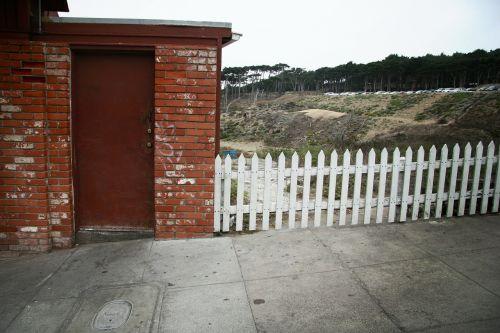 crooked fence door