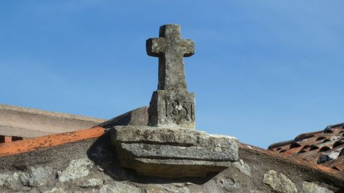 cross rooftop stonework