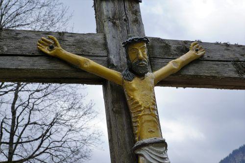cross allgäu behind stone
