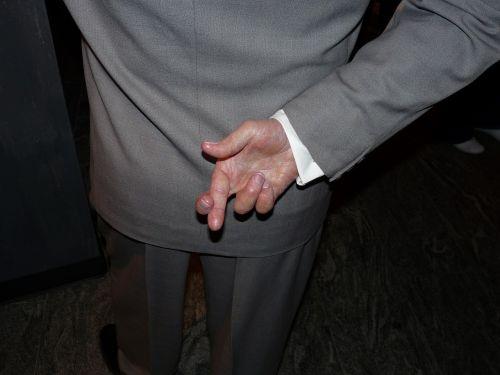 crossed fingers cross fingers gesture