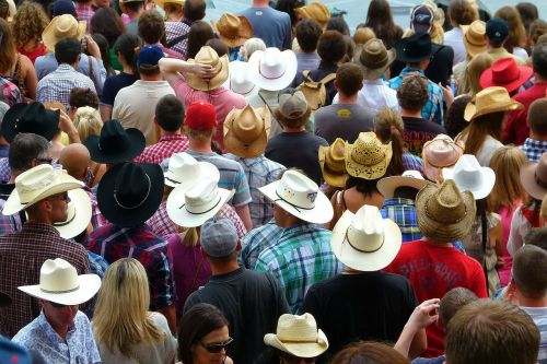 crowd heads hats