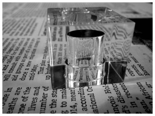 Cubic And Newspaper