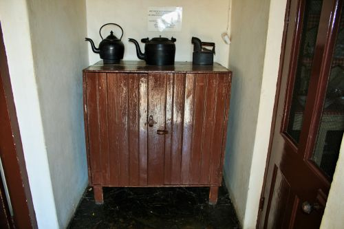 Cupboard With Old Iron & Kettles