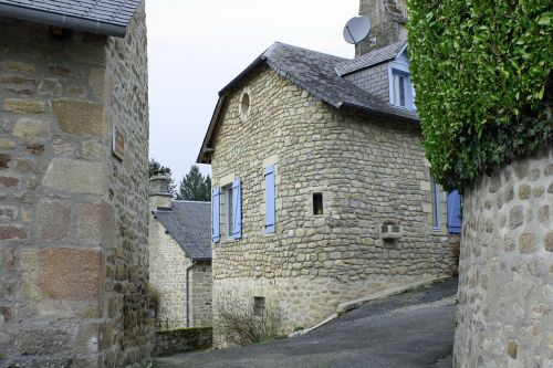curved house wall old stone building french house