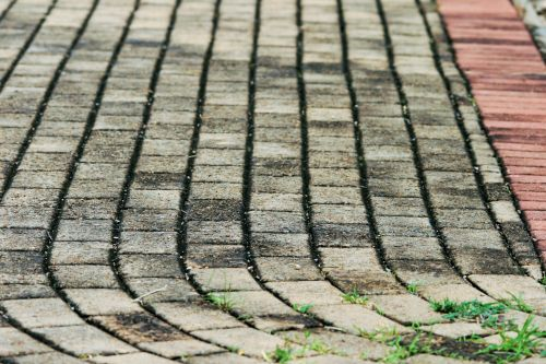 Curving Grey And Red Paving