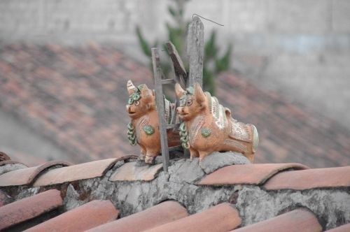 cusco peru inca ornaments roof tops