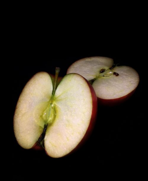 cut apple apple black background