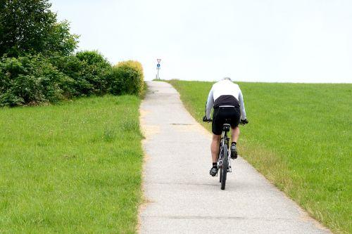cyclists drive bike
