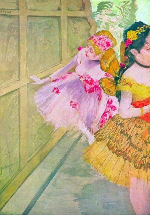 Dancers Behind A Backdrop