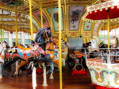 dancing roundabout horses carousel colorful