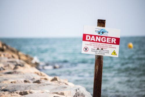 danger sign beach