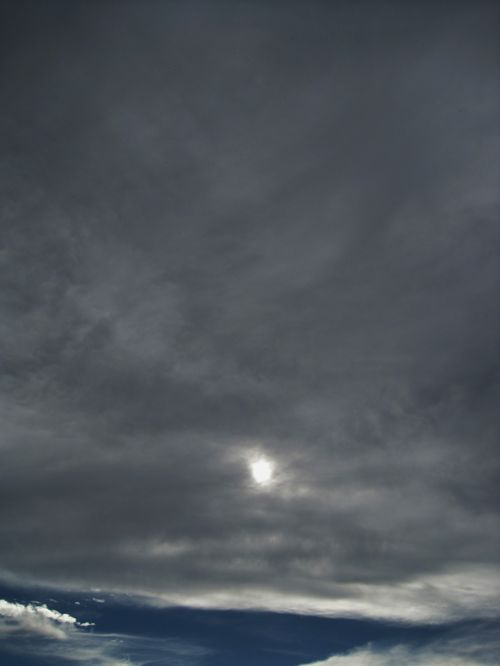 Dark Sky With Penetrating Sun