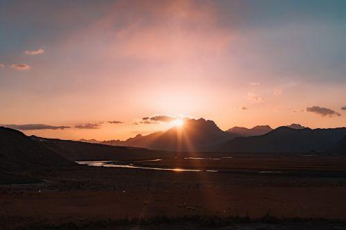dawn mountain sunbeams