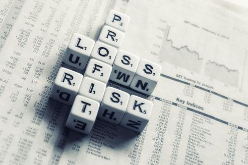 dices over newspaper profit loss risk