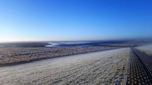 dike in winter on the island of borkum