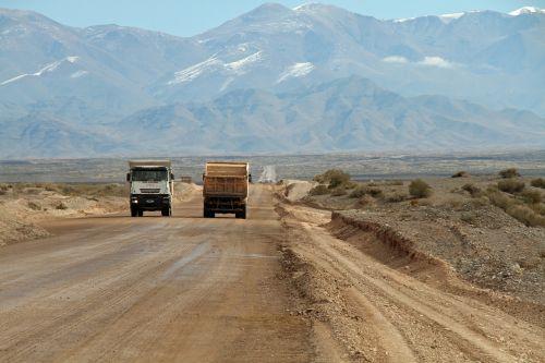 dirt road trucks mountains