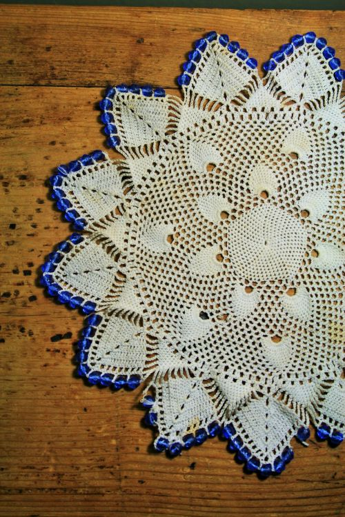 Doily On Wood Surface