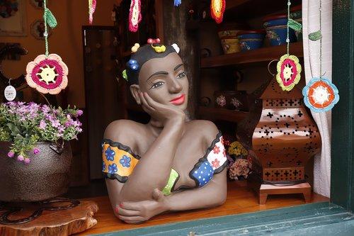 doll  statue  window