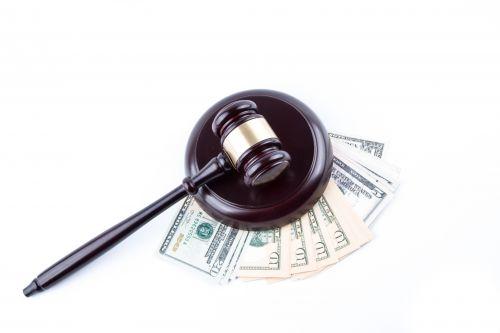Dollar Banknotes And Judge's Gavel