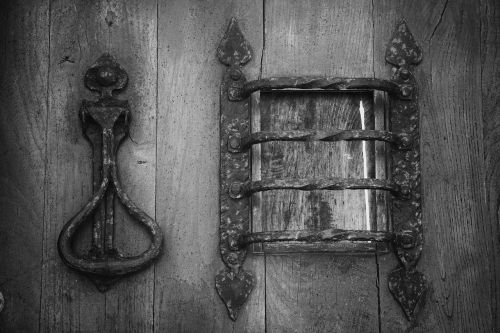 door,wrought iron,metal,knocker,wooden door,forged,old door hinge door,black and white,heart