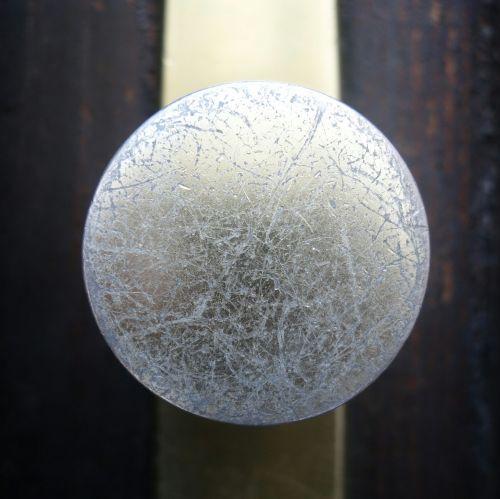 door knob scratched brass