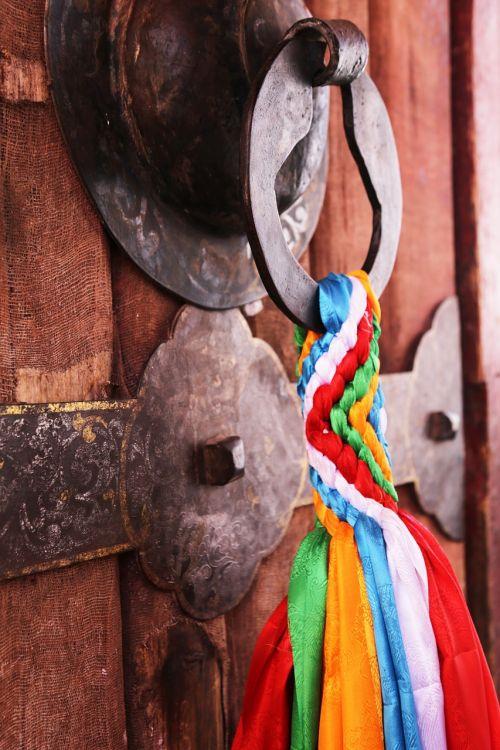 door lock prayer flags tibet