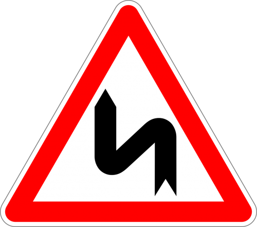 double curve first to left traffic sign sign