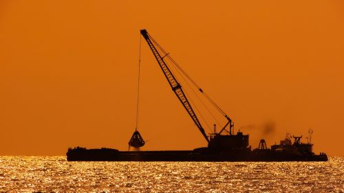 dredger floating platform sunset