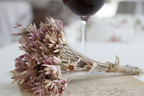 dry flowers  letters  wine