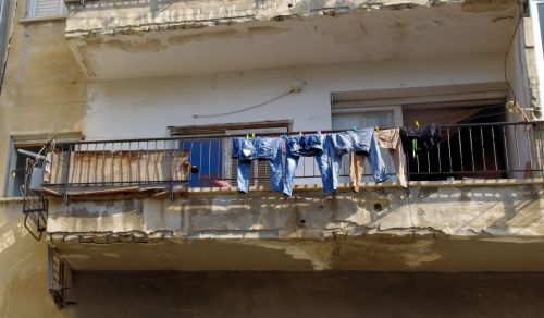 Drying Clothes On A Balcony