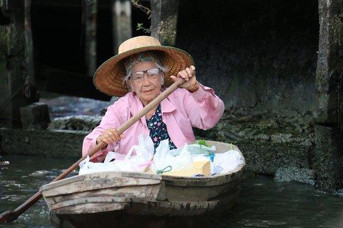 elderly woman  boat  vessel