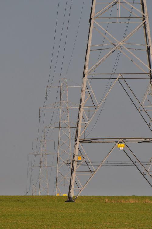 electricity pylon field electricity