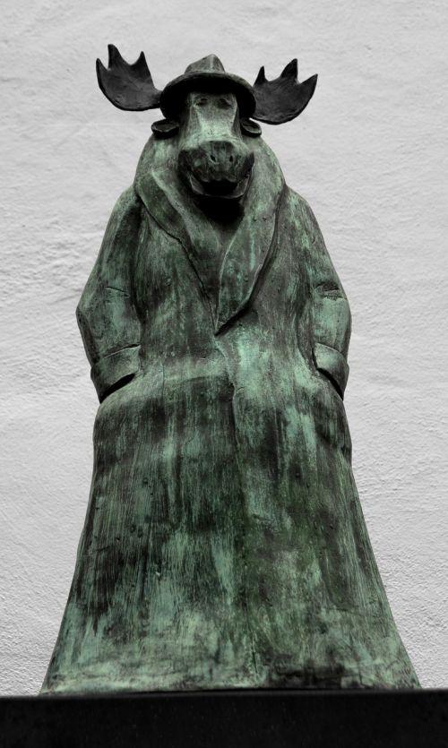 elk statue caricature