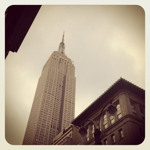 empire state building new york city cloudy day