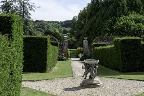 english country garden formal yew hedges sundial sculpture