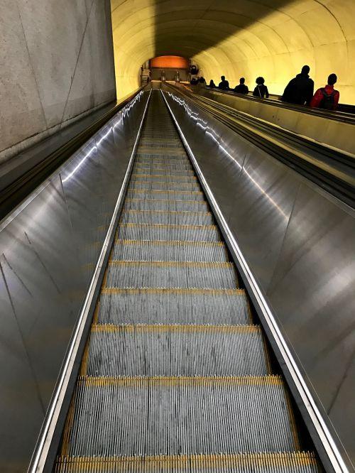 escalator subway commuters