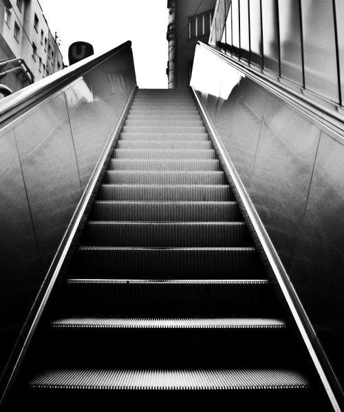 escalator black and white stairs