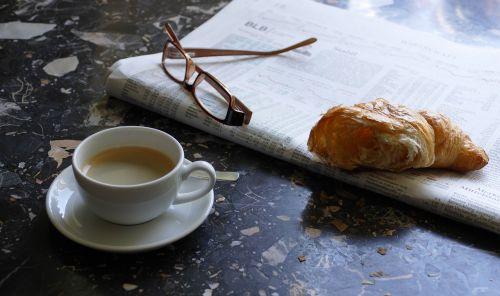espresso newspaper croissant