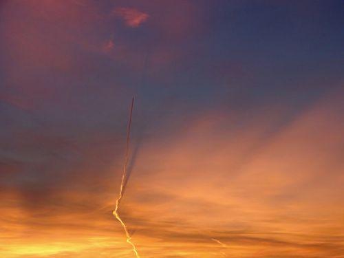 evening sky aircraft contrail