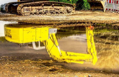 excavators water mirroring