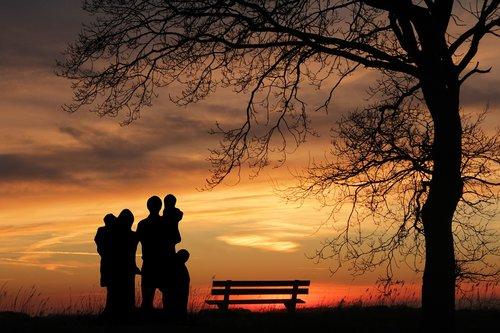 family  sunset  woman