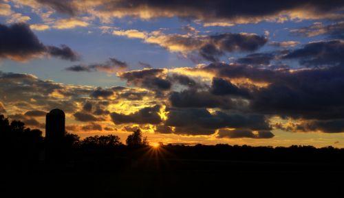 farm silo sunset