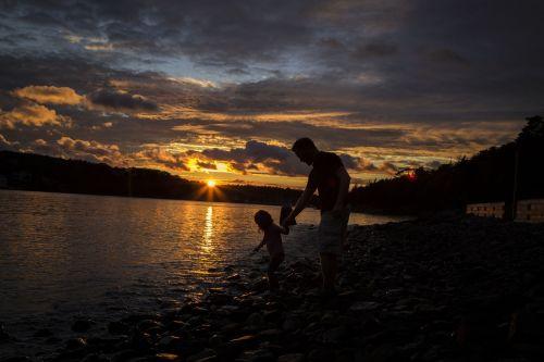 sunset water daughter