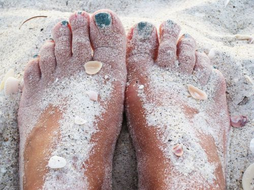 feet in the sand warm sand beach