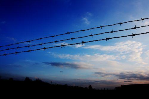 fence sunset sky