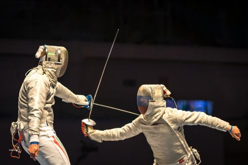 fencing people playing